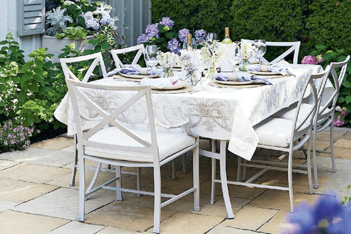 white table with white chair and floral place setting