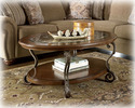 Signature Design By Ashley T517-0 Nestor - Medium Brown Oval Cocktail Table