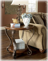 Signature Design By Ashley T517-6 Nestor - Medium Brown Round End Table